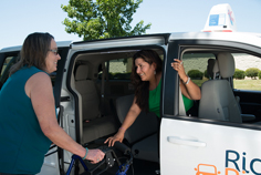 Woman departing van
