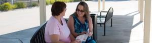 Women at bus depot looking at bus map