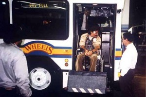 Wheels bus using wheelchair lift